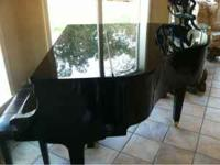 Beautiful Wurlitzer ebony baby grand piano. See pics.