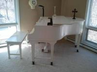 Wurlitzer Baby Grand Piano,$800.00. Call for details .