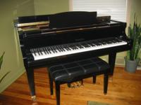 WURLITZER BY BALDWIN EBONY FINISH GRAND PIANO. STEPS