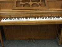 Come on in and check out this used oak Wurlitzer