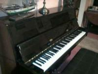 Upright Glossy Ebony Wurlitzer Piano. Purchased new