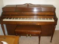 A very beautiful spinet piano by Wurlitzer with