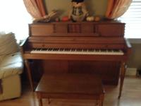 This upright piano & & bench is priced right- it is