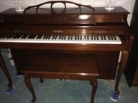 FOR SALE IS A USED WURLITZER PIANO , 15 YEARS OLD BUT