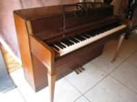 Lovely Wurlitzer spinet piano by Baldwin. Walnut