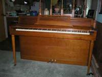 "Piano with bench 41""high x 56"" long x 24"" front to"