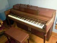 wurlitzer spinet piano with bench ,,,,older ,,age