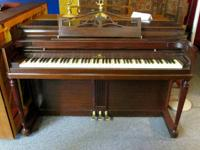 Beautiful mahogany Wurlitzer spinet piano with bench.