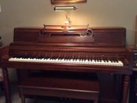 Wurlitzer spinet piano, bench seat with storage, light