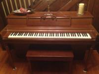 Wurlitzer Upright Piano  In good condition but does