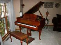 Beautiful Wurlitzer grand with beautiful dark cherry