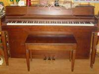 Nice Wurlizer Melville Clark Piano. Walnut finish with