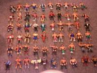 A wide range of wrestling collectibles from the 80's,