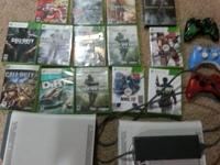 For sale x box 360 that works great with 14 games, 3