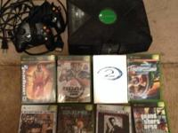 Regular xbox with 8 games and 2 controllers. Works