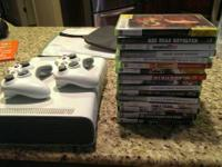 Xbox 360 with power cords, 2 controllers, and 16 games