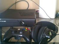 I have a Xbox 360 slim 250gb model. It comes with one