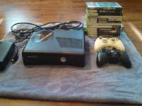 4gb Xbox 360 slim with 2 controllers and 12 games. Call