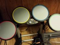 Selling 2 guitars and drum set in working condition.