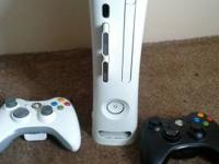 White Xbox 360 with 13 GB plus two 50 MB memory cards.