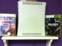 XBox 360 w/ Call of Duty and UFC Unleased games. All