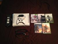 Xbox 360 (white) with 16 GB hard drive.  Includes 5