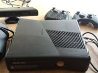 xbox 360 with kinext. two remote controls included (one