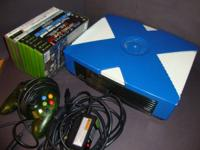 This xbox includes games, control, memory card, and