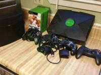 regular xbox 30 games 2 controllers and 2 memory slots