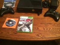 xbox slim in perfect condition with two controllers and