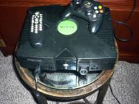 Xbox with controller and attachments, includes a game