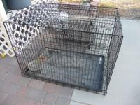 XL kennel with 2 doors, excellent condition. Call  to