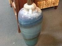 This signed extra large vase stands at 2 ft 3 inches.