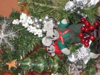XMAS FLOWER ARRANGEMENTS FORM 15.00 TO 25.00  Location: