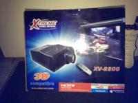 It's a 3D LCD projector . The brand is XTREME home