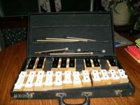 old xylophone in hard case. sticks included. nice