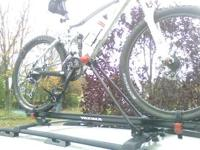 Yakima Raptor Aero roof mounted bike rack for sale. One