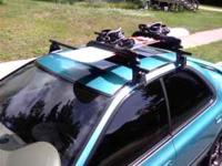 Complete Yakima roof rack system with snowboard mounts.
