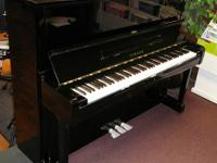 This is an extremely young Yamaha U1 acoustic piano,