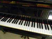 Yamaha 5'3' Grand piano with bench.. This is a Japanese