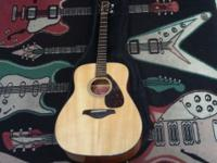 This acoustic guitar is from Yamaha, the FG700S. It