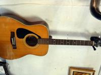 nice Yamaha FG-335 acoustic guitar. It is strung for a