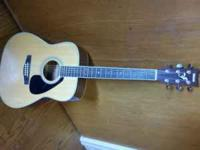 Very lightly used Yamaha FG - 423S guitar. Lots of free