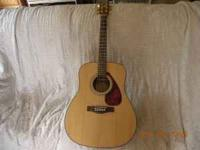 Great Yamaha F335 acoustic guitar. Plays great. Just