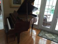 a seldom used, in beautiful condition Yamaha baby grand