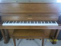 This is a Yamaha Center size piano for sale. It excels