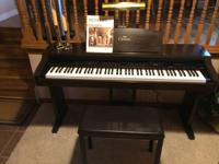 Piano (Model #CVP-83S) is in excellent condition and