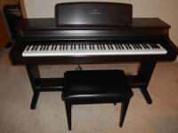 Selling a Yamaha CLP-154S piano.full size