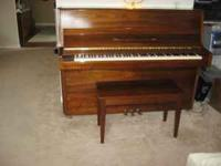 This is is a beautiful walnut piano that was purchased