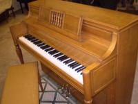 Yamaha console piano, model M2I and bench in natural